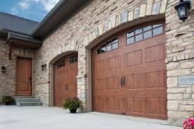 the clopay reserve wood collections offer diffe takes on real wood garage doors or you can also achieve the high end look at a lower by