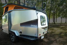 this camping trailer may be quite compact and lightweight but it makes most of its limited space to accommodate two s along with two children
