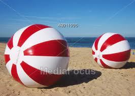 Beach ball in sand Sea Huge Red White Beach Balls In The Sand Stock Photo Dhgatecom Stock Photo Huge Red White Beach Balls Sand Image 48011006 Huge
