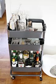 Easy IKEA Hack: Raskog utility cart used as a portable bar cart in a small