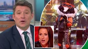 Sausage who is all wrapped up in a newspaper but will bush baby is an adorable looking cheeky fluffy fella but will the voice match the cute appearance? Ben Shephard Refuses To Deny He Is Badger On The Masked Singer Heart