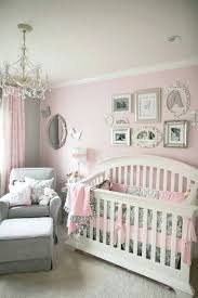 marvelous crystal chandelier illuminating the baby nursery which is using baby girl bedroom ideas and also equipped with white mini crib and comfortable
