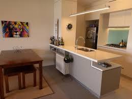 a kitchen or kitchenette at 2 bed modern inner city apt riverside gardens