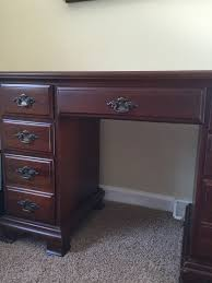 i have a young hinkle seven drawer secretary or desk it has dovetailed d