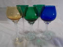 6 glass pieces 5 feet tinted glasses a large glass with decorative ball style candy jar