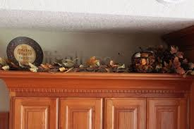 decor above kitchen cabinets red teapot brown counter sets tile regarding decorating ideas for above kitchen
