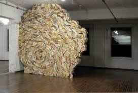 british artist jonathan callan creates impressive organic figures using books that are curled wrapped and folded together using s