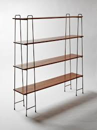 A free standing shelving unit achieves a minimal look, which is honest to  its materials