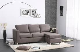 furniture grey fabric couch with three seats and back added by rectangle beige fur rug