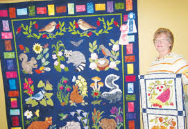 Longview woman featured at this year's Ladies of the Lake Quilt ... & Betty Davis of Longview is shown here with the quilt 'Woodland Creatures'  which earned her the award of grand champion at the 2014 Cowlitz County  Fair. Adamdwight.com