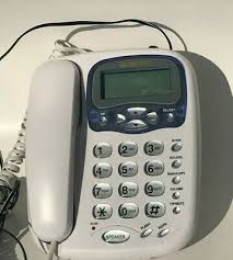 curtis corded telephone white wall