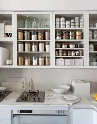 designer michael scherrer upgraded her pasadena kitchen by removing the doors altogether and painting the cabinets