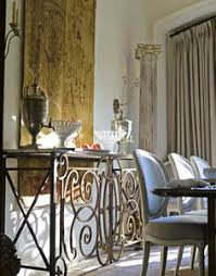 a railing from a spanish balcony became part of a sideboard in the dining room
