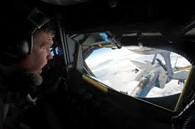 Air Force Tech. Sgt. Bill Paull refuels a U.S. Air Force F-15E ...
