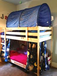 bedroom brown wooden bunk bed with blue owls tent combined with pink bed sheet and