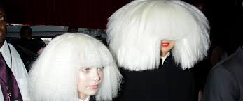 the story of kristen wiig s crazy cameo in sia s grammys performance cbs com