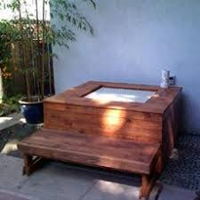 outdoor japanese soaking tub. great idea taking an inexpensive indoor ofulo and creating outdoor soaking hot tub from it. japanese i