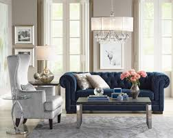 a living room with a handmade velvet tufted sofa and mercury glass table lamp d51