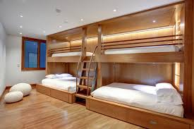 Exceptional Zone 4 Architects Designed This Wooden Bunk Bed Unit, With Hidden Lighting  And Storage, That Has Two Larger Beds Located Below The Two Upper Bunks, ...