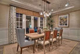 cottage style dining room light fixtures with pottery barn rug also using leather wingback chairs