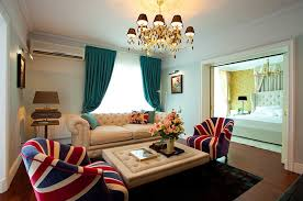 furnitures small living room with patterned sofa ans neutral tufted coffee table under classic chandelier