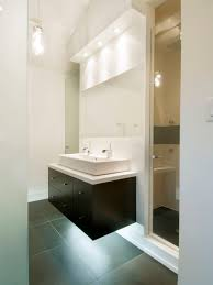 contemporary gray tile bathroom idea in toronto with a trough sink flat panel cabinets