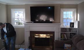 fireplace with tv mounted above