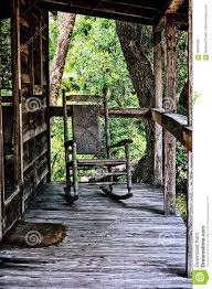 old rocking chair on porch of house stock p o image 68947028