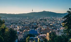 pros cons of moving to a new country com living abroad for a year in barcelona spain cityscape
