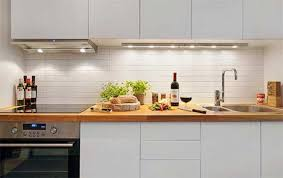 kitchen decorating ideas for apartments. Kitchen, Minimalist White Apartment Kitchen Design Space Wooden Countertop Cabinet Lamps Under Backpalsh Stove Tile Decorating Ideas For Apartments