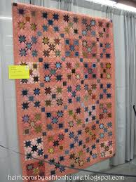 Heirlooms by Ashton House: A VISIT TO THE AMERICAN QUILTER'S ... & I have a weakness for pink 1800s reproduction fabric, so this quilt  definitely struck a chord. I loved the scrappy stars. Adamdwight.com