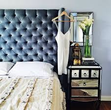 Make your room look more expensive with a blue velvet tufted headboard and  a mirrored bedside