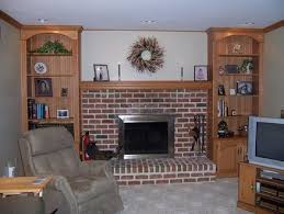 built in bookcases mantel fireplace family room