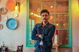 business denim jacket handsome house indoors jacket lights man mustache person plates portrait pose reflection restaurant
