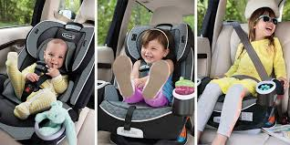 a baby toddler and little girl buckled into their car seats