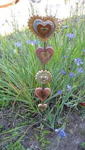 ceramic garden totem with 4 handcrafted hearts and a flower three clay hearts imprinted with