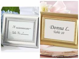 wedding decoration craft of silver and gold photo frame also as place card holder for party favors and guest gifts wedding decoration craft party favors