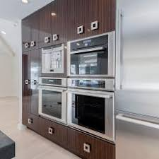 built in appliances.  Appliances Wall Of Kitchen Cabinets Features BuiltIn Appliances In Built