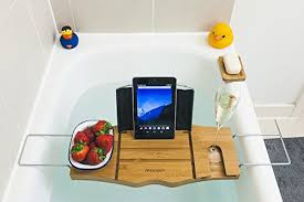 wooden bath caddy over bathtub shelf with a wine glass holder