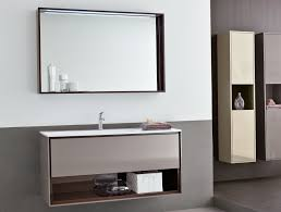 large bathroom mirror with shelf above single sink wall mounted bathroom vanity and two tall bathroom cabinets