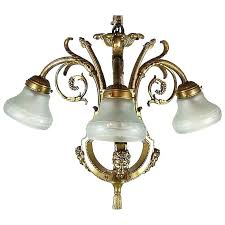 vintage brass chandelier with gs and or satyr masks antique canopy