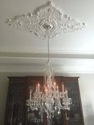 ceiling medallion installation an off white chandelier
