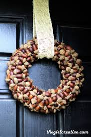 DIY: How to Make an Acorn Wreath for Fall - simply glue acorns onto a