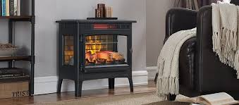 a small elegant black fireplace in a room