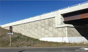 a mechanically stabilized earth mse retaining wall is a composite structure consisting of alternating layers of compacted backfill and soil reinforcement