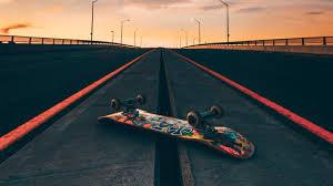 wallpaper of skateboard road marking sunset bridge background hd image