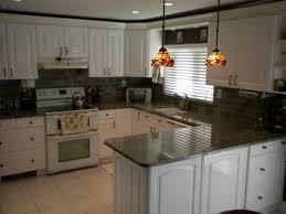 white kitchen cabinets dark granite countertops