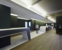 contemporary office lighting. interior contemporary office design hallway with wood flooring dark green colored walls and modern lighting