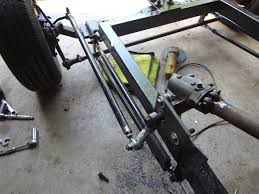 many of the old straight axles had a steering arm that twisted down to the lower end of the spindle housing most sd s offer aftermarket steering