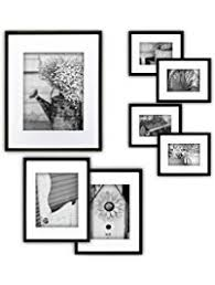 black picture frames. Gallery Perfect 7 Piece Black Photo Frame Wall Kit. Includes: Frames, Hanging Picture Frames